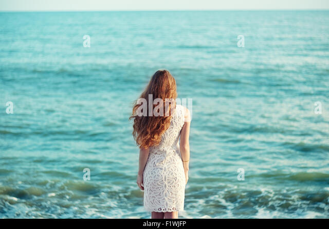 Beautiful woman with red hair at the sea. Fashiob photo - Stock-Bilder
