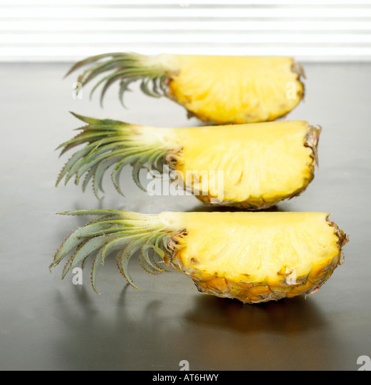 Sliced baby pineapples, close-up - Stock Image