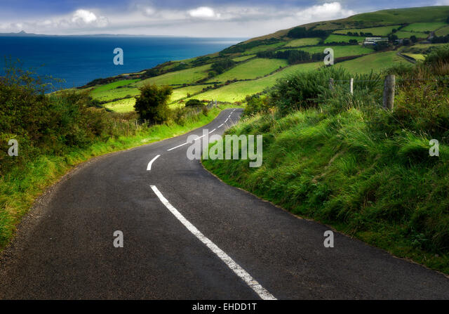 Road near Torr Head with green fields in background. Antrim Coast Northern Ireland - Stock Image