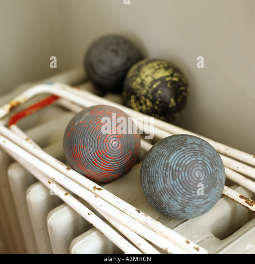 Old fashioned croquet set on cast iron radiator - Stock-Bilder