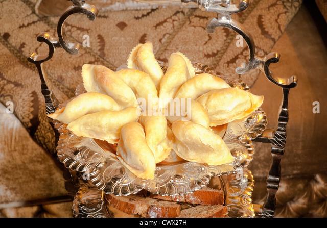 Moroccan pastry, cornes de gazelle, in a silver dish. - Stock Image
