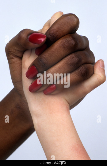 Black and white hands clasped in harmony and friendship - or fighting - Stock-Bilder