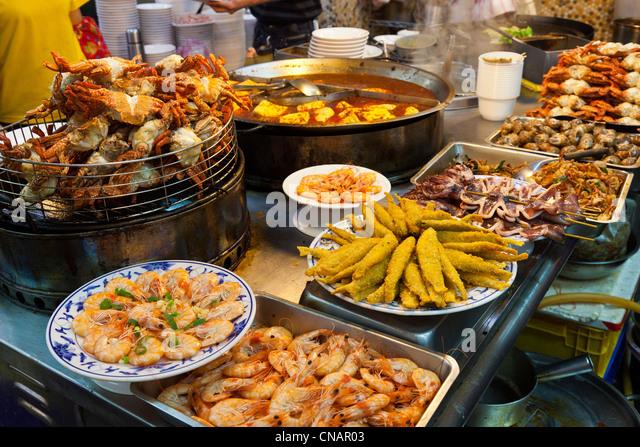 Seafood snacks stall in Shilin Night Market Taipei Taiwan. JMH5995 - Stock Image