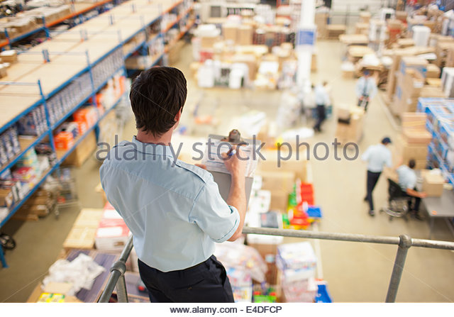 Supervisor  monitoring shipping work - Stock Image