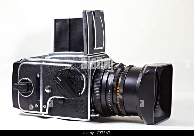 Legendary Hasselblad 500 CM medium format 120 roll film camera and lens with hood - Stock Image