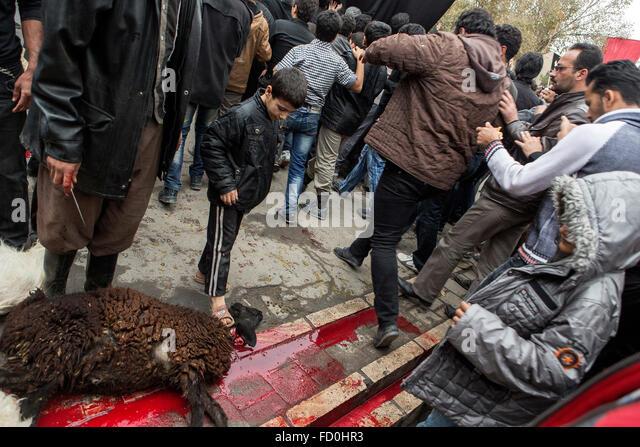Sacrifice furing Ashura ritual in Kashan, Iran. - Stock Image
