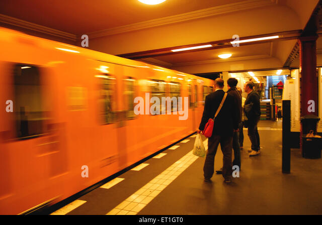 People waiting for subway trains ; Germany - Stock Image