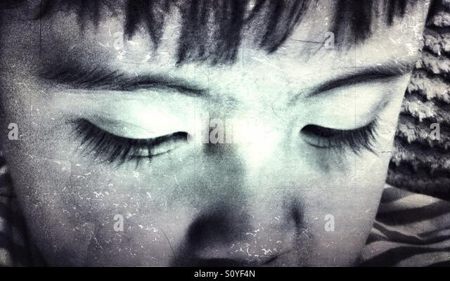 Close up of a young boy's eyes. - Stock Image