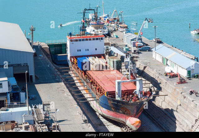 Ship in dry dock, Port of Christchurch, Lyttelton, Lyttelton Harbour, Banks Peninsula, Canterbury, New Zealand - Stock Image