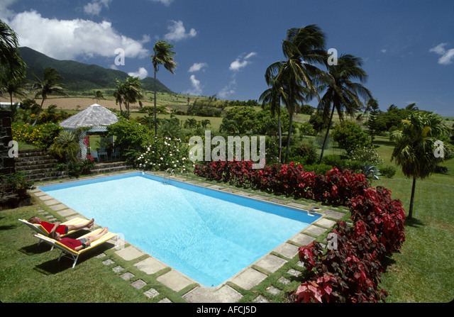 West Indies St. Kitts Rawlins Plantation 1690 sugar plantation now resort swimming pool garden sugar cane Mt. Liamuiga - Stock Image