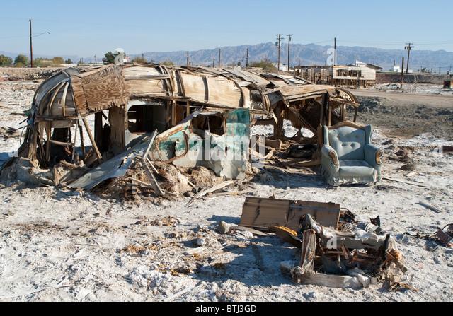 Broken sofa and trailer in Bombay Beach, Salton Sea, California - Stock Image