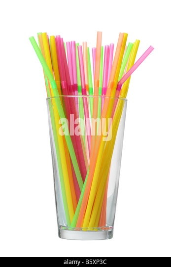 Glass of colorful straws cutout isolated on white background - Stock Image