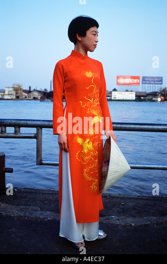 Vietnamese Woman in Traditional Dress - Stock Image