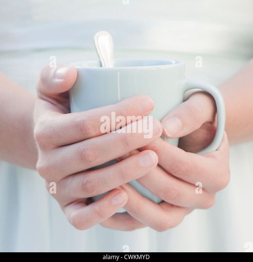 woman hands holding a cup - Stock Image