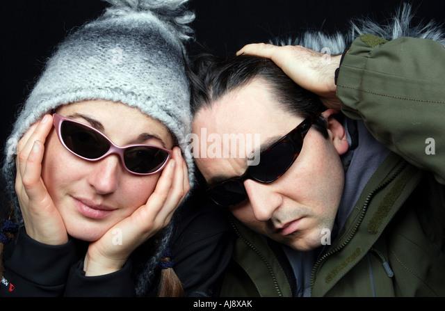 Joyful couple wearing sunglasses. - Stock Image