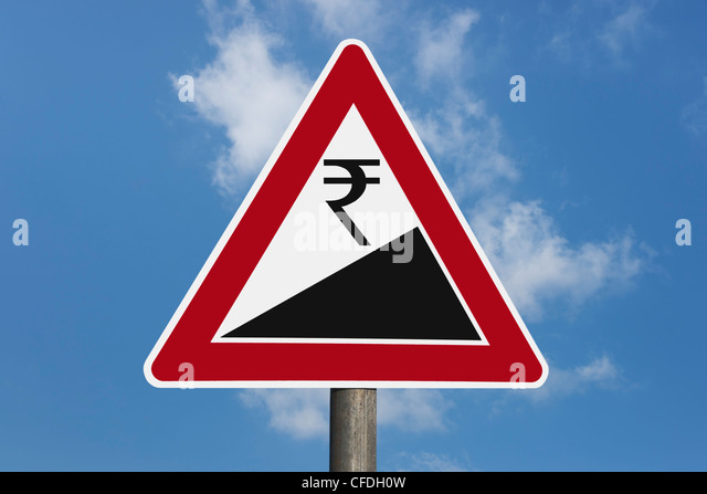Detail photo of a danger sign 'Upward gradient' with a Indian Rupee currency sign, background sky. - Stock-Bilder