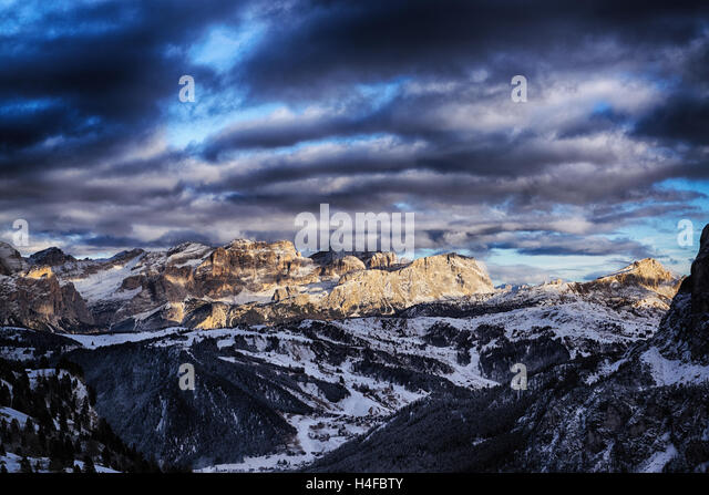 last sunny lights of the day in a beautiful sunset over the mountains of Alta Badia, Trentino-Alto Adige - Italy - Stock Image