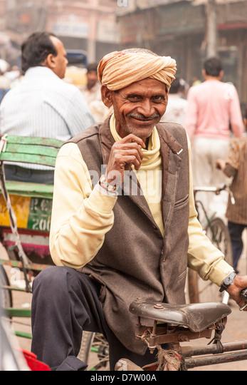 Rickshaw driver, Delhi, India - Stock Image