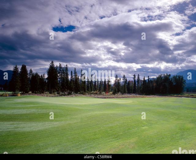Lush green fairway and green, Riverside Golf Club, Fairmont Hot Springs, British Columbia, Canada. - Stock Image