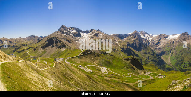 Panoramic view on Grossglockner High Alpine Road, Austria. Range of mountain peaks and highland serpentines - Stock Image