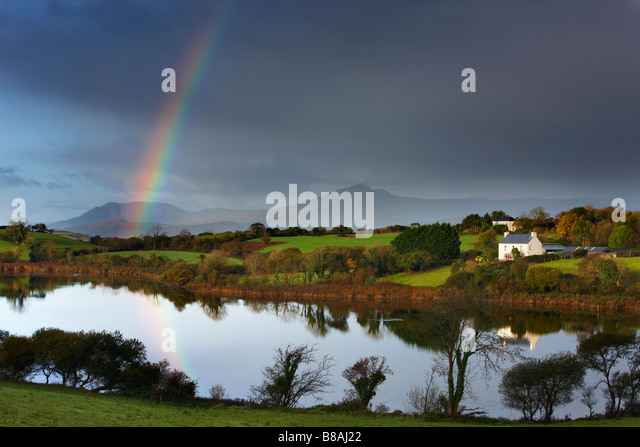 dawn over Bantry Bay, with a rainbow nr Bantry, County Cork, Ireland - Stock-Bilder