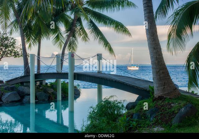 Bridge over infinity pool at the Intercontinental Tahiti hotel. Tahiti. French Polynesia - Stock Image