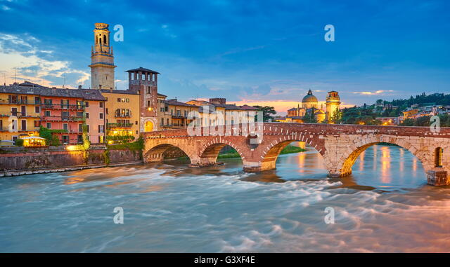 Ponte Pietra Bridge at evening dusk, Verona old town, Veneto region, Italy - Stock Image