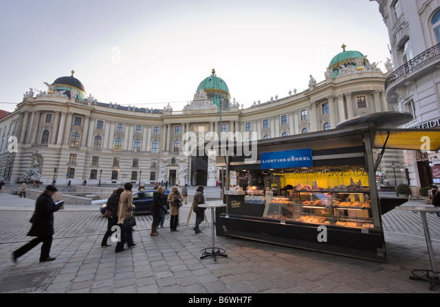 Kiosk selling donuts and pretzels in Michaelerplatz, Vienna, Austria - Stock Image