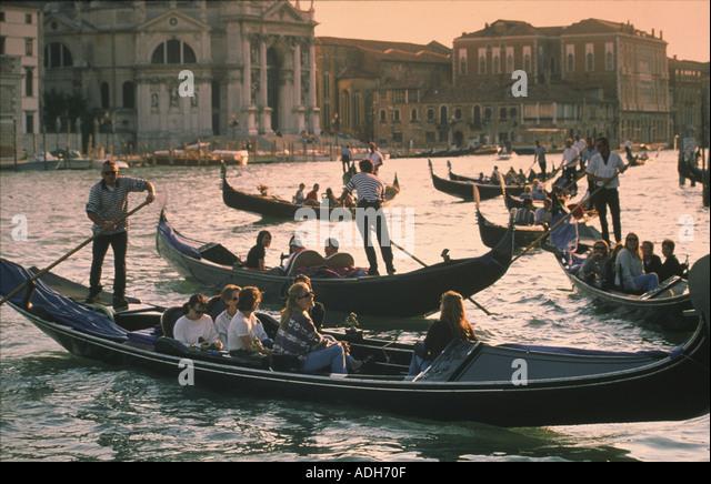 Italy Venice Riva degli Schiavoni Canale Grande Riva degli Schiavoni Gondola pier sunset Santa Maria della Salute - Stock Image