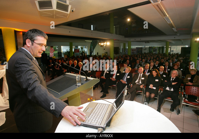 Rhineland-Palatinate Minister for Economic Affairs Hendrik Hering giving a presentation with laptop at an economic - Stock Image