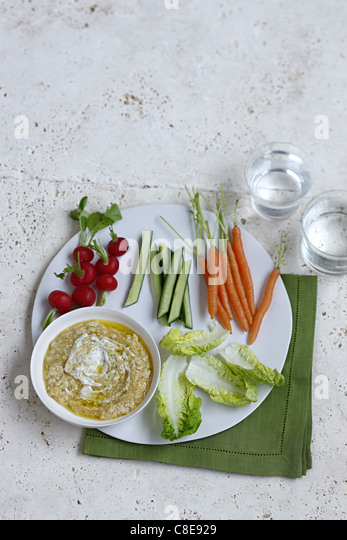 Raw vegetables with eggplant caviar dip - Stock Image