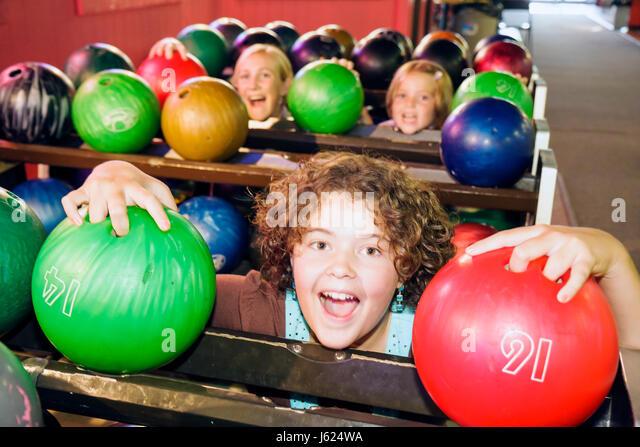 Indiana Valparaiso Inman's Fun and Party Center bowling ten-pin bowling balls green red girls teen play amusement - Stock Image