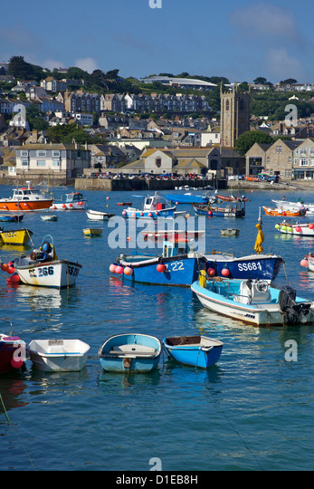 Summer sunshine on boats in the old harbour, St. Ives, Cornwall, England, United Kingdom, Europe - Stock Image