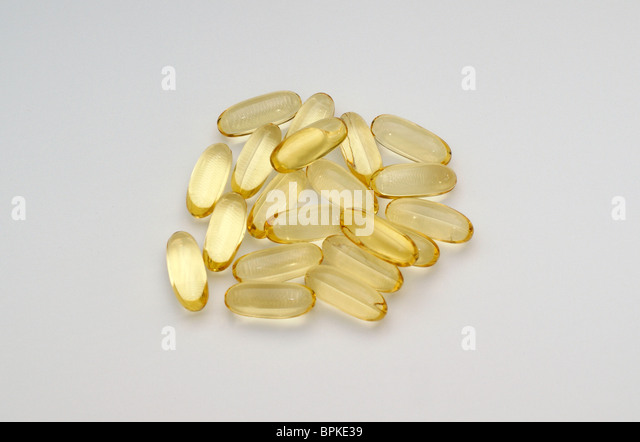 omega 3 fish oil tablets beneficial for heart health low cholesterol levels & a calming effect on hyperactive - Stock Image