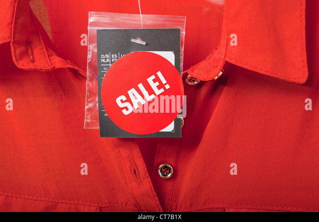 Sale tag on red blouse - Stock Image