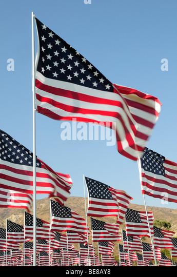 USA, California, Los Angeles, 9/11 Memorial at Pepperdine University in Malibu with multiple union flags flying - Stock-Bilder