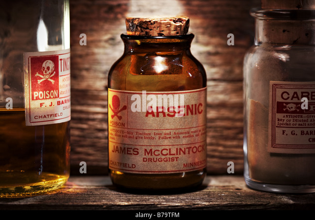 Vintage arsenic poison bottle on antique shelf - Stock Image