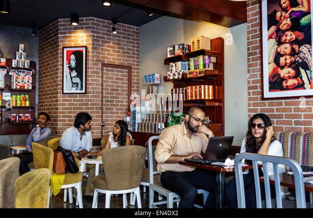 Mumbai India Asian Churchgate Jamshedji Tata Road Cafe Coffee Day restaurant inside man woman couple - Stock Image