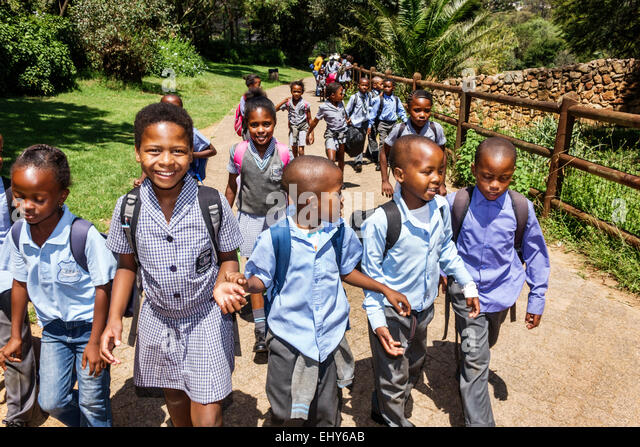 Johannesburg South Africa African Zoo Black boy girl student class field trip uniform - Stock Image