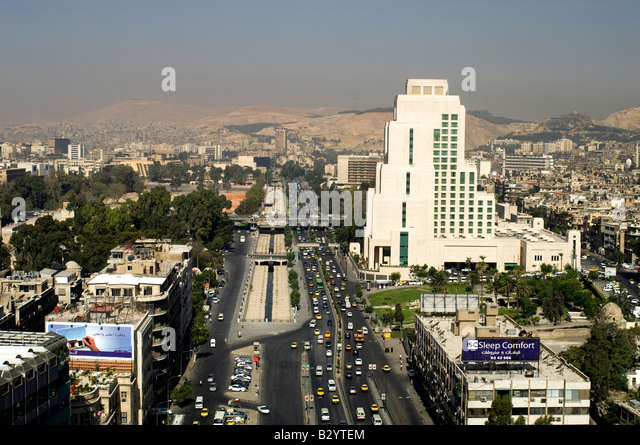 Syria. Morning traffic on wide Beirut Avenue in the modern part of Damascus - Stock Image
