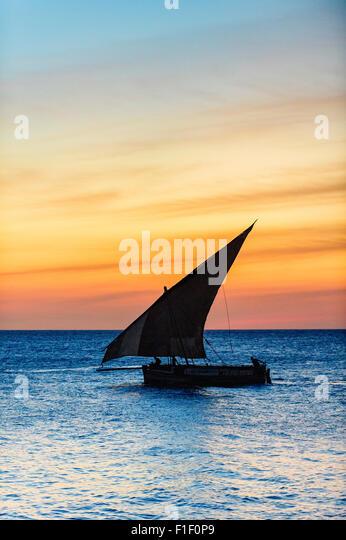 Arab Dhow Zanzibar Tanzania at sunset - Stock-Bilder