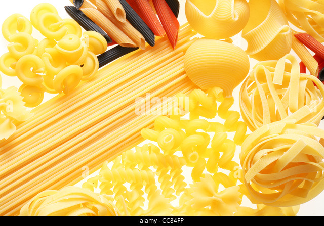 Close up shoot of different types of raw pasta. - Stock Image