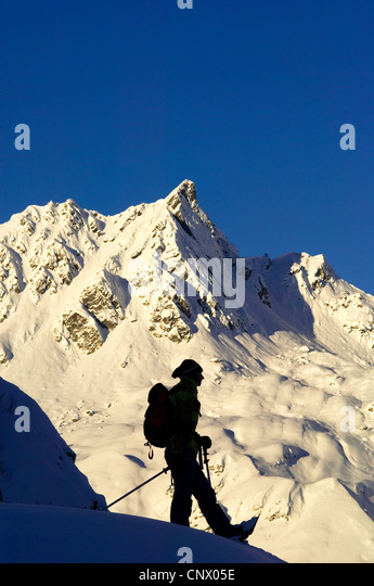 snow shoe hiker in north of Alps mountains, France, France - Stock Image
