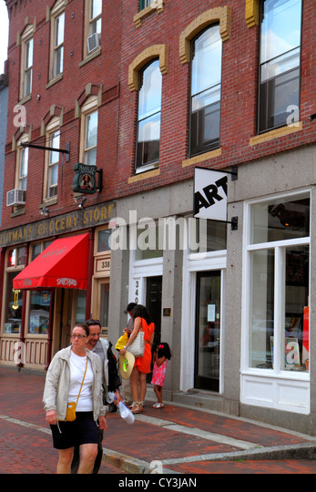 Maine Portland Historic Old Port District man woman couple buildings - Stock Image