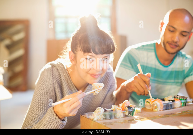 Couple eating sushi together - Stock Image