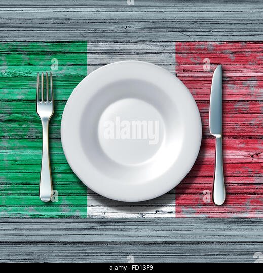 Italian cuisine food concept as a place setting with knife and fork on an old rustic wood table with a symbol of - Stock-Bilder