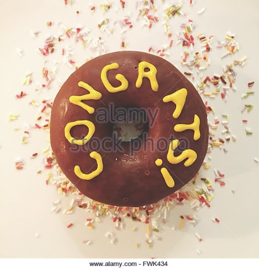 Close-Up Of Text On Donut In Plate - Stock Image