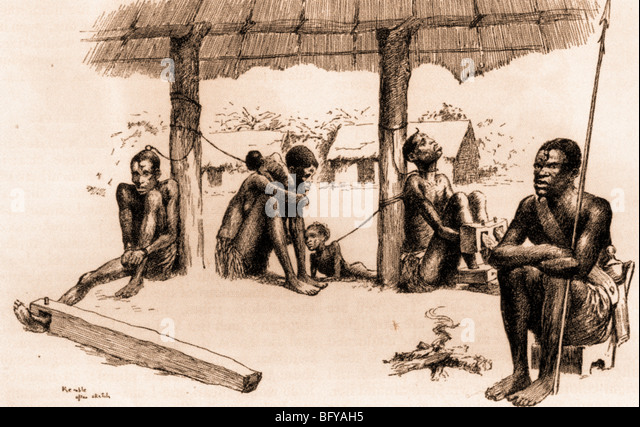 CAPTURED SLAVES in the Belgian Congo await the arrival of a slave trader - Stock-Bilder