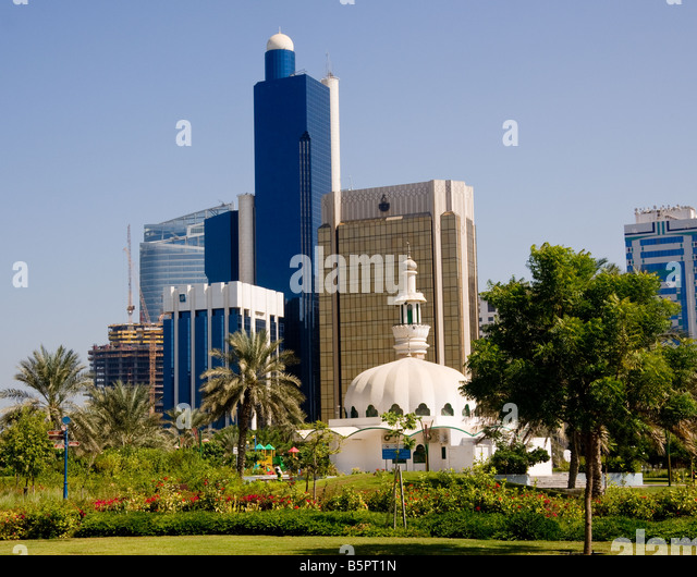 Abu Dhabi, UAE - office buildings from an urban park - Stock Image