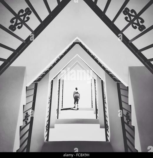 Man Walking In Abstract Building - Stock Image